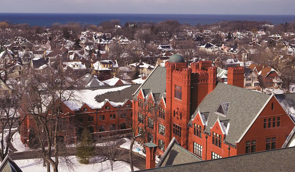 An aerial view of Campus, neighboring houses, and Lake Michigan in winter.